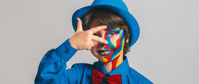 child in face paint and blue suite